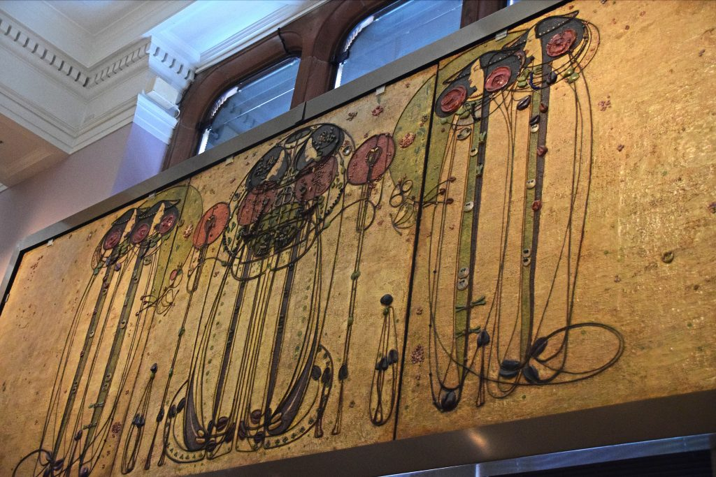 The Wassail, from the Ladies' Luncheon Room, Ingram Street Tea Rooms, 1900, Charles Rennie Mackintosh, Kelvingrove Museum, Glasgow, Scotland.  Oil on gesso plaster on hessian and scrim, twine, glass beads, thread, mother of pearl, tin leaf.   Mackintosh made these panels along with his wife, Margaret Macdonald, who was a celebrated artist in her own right.